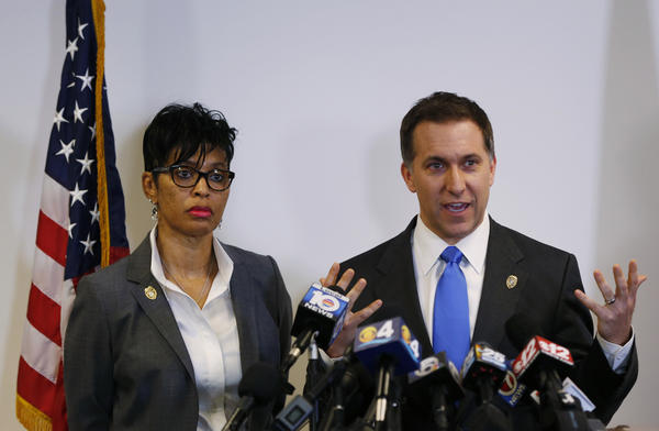 Palm Beach County, Fla., State Attorney Dave Aronberg, accompanied by Assistant State Attorney Adrienne Ellis, speaks during a news conference in West Palm Beach, Fla.