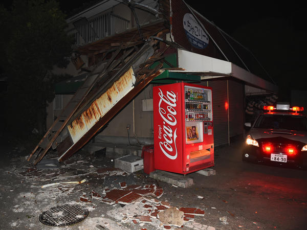 A partially collapsed house is seen after southern Japan was struck with a 6.2-magnitude earthquake.