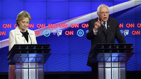 Democratic presidential candidates Bernie Sanders and Hillary Clinton debate in Brooklyn Thursday.