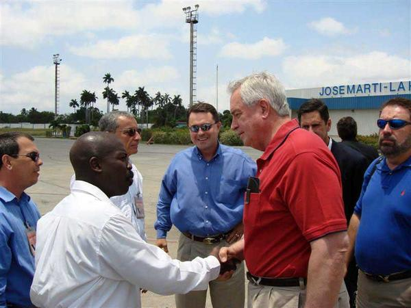Texas Farm Bureau President Kenneth Dierschke (right) and Texas Agriculture Commissioner Todd Staples (middle) being greeted by Cuban officials in 2008 during a state-sponsored trip.