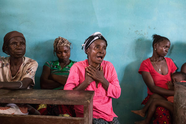 A woman speaks at a support group for residents of a community in Bong County, Liberia, who are suffering the psychological aftermath of the Ebola crisis. International Medical Corps set up the group to complement the medical services it has offered to patients.