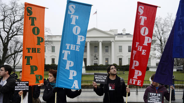 Activists hold a rally to protest the Trans-Pacific Partnership trade agreement in front of the White House on Feb. 3. Trade has become a key issue in the U.S. presidential campaign.