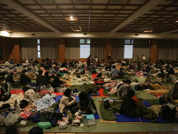 People sheltering at the evacuation center at the Mashiki Town Gymnasium feel the 7.0 magnitude earthquake that struck southern Japan a day after another earthquake in the same area killed nine people.