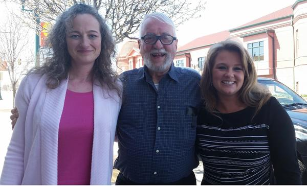 Jack McCullough enjoys his first moments of freedom in nearly five years with stepdaughter Janey O'Connor, left, and Crystal Harrolle, an investigator who helped find information he used to pursue his release.