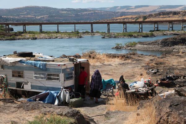 <p>This August 2014 photo shows the home of Ranetta Spino and her family at the river's edge at Lone Pine, a Native American fishing site on the Columbia River near The Dalles, Oregon. Lone Pine is one of 31 fishing sites developed as a replacement for tribal fishing grounds flooded or destroyed by hydroelectric dams. About 40 people, including children, permanently live at the fishing site in substandard conditions.</p>
