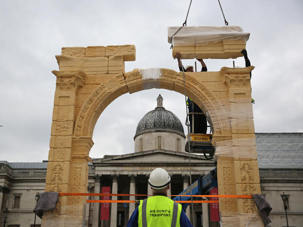 A replica of Palmyra's 2,000-year-old Arch of Triumph is constructed in London's Trafalgar Square on Monday. The arch, a replica of a monument demolished by ISIS, was made using 3-D imaging produced from photographs.