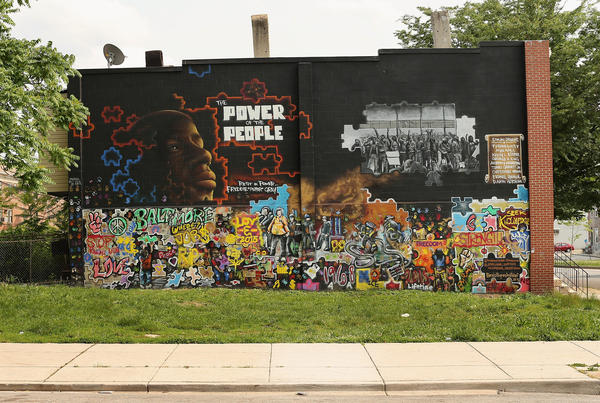 A mural memorializing Freddie Gray is painted on the wall near the place where he was tackled and arrested last year by police at the Gilmor Homes housing project in Baltimore, Md.