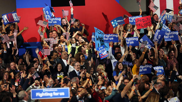 Supporters cheer Tuesday in New York City as Democratic presidential candidate Hillary Clinton is called the winner of the New York primary.