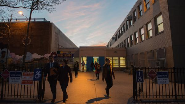 People exit the building after voting at P.S. 282 in Brooklyn on Tuesday.