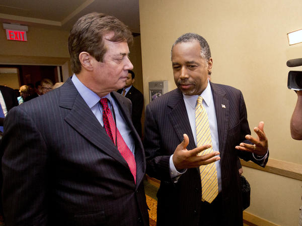 Donald Trump strategist Paul J. Manafort, left, chats with former presidential candidate Ben Carson, as they head to a reception at the Republican National Committee Spring Meeting, Thursday.