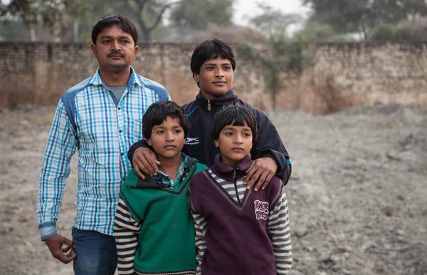 Neetu with her husband, Sanjay Kumar, and their twin sons, Prince and Ayush.