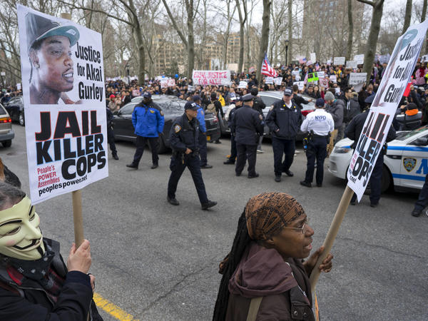 A group of counterprotesters stand across the street from hundreds of protesters attending a rally supporting Peter Liang on Feb. 20 in Brooklyn, N.Y.