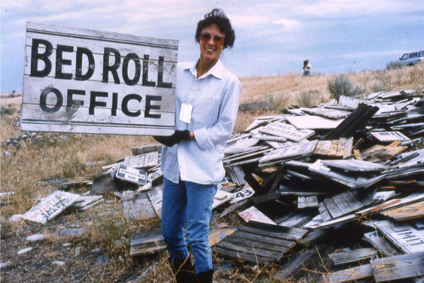 Hanford historian Michele Gerber displays a wooden sign for the World War II Hanford Construction Camp. The signs were found and retrieved from the desert on the Hanford Site in 1991.