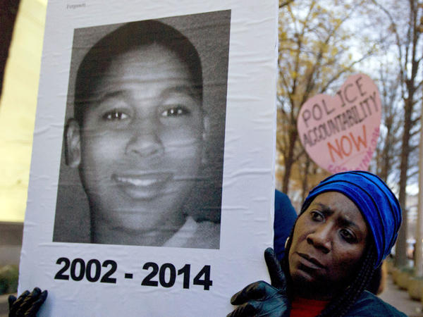 A protester holds up a picture of 12-year-old Tamir Rice in a December 2014 demonstration in Washington, D.C.