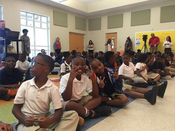 Students at Tiger Academy Elementary School in Jacksonville anxiously await special guest Taboo from The Black Eyed Peas.