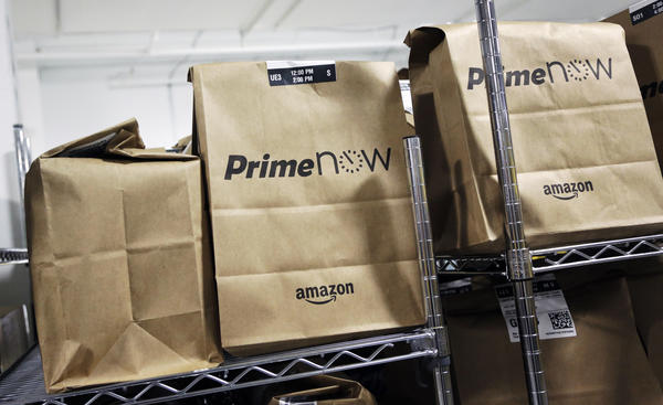 Bags are loaded for delivery at Amazon's urban fulfillment facility in New York last year. In some areas, Amazon Prime subscribers can get free same-day delivery.