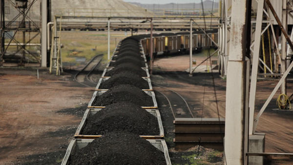 <p>File photo of a coal mining operation in Wyoming. Government officials there want to use state money to help finance construction of shipping terminals in the Northwest to export Wyoming coal to Asia.</p>