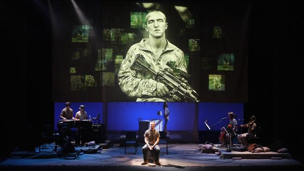 <em>BASETRACK Live</em> incorporates photographs, videos and interviews to tell the story of warfare, both at home and abroad.