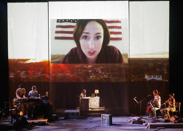 In the performance, an actress playing the wife of a Marine talks to her husband via Skype.
