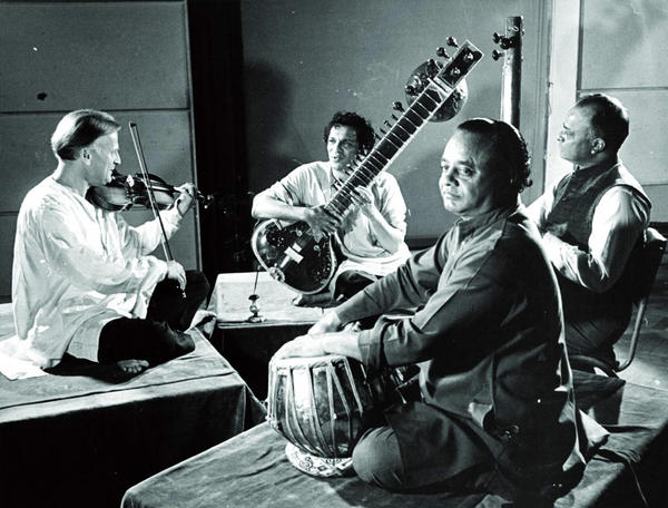 In 1952, Menuhin traveled to India, where he met Ravi Shankar (second from left). The two men recorded three albums together and became lifelong friends.
