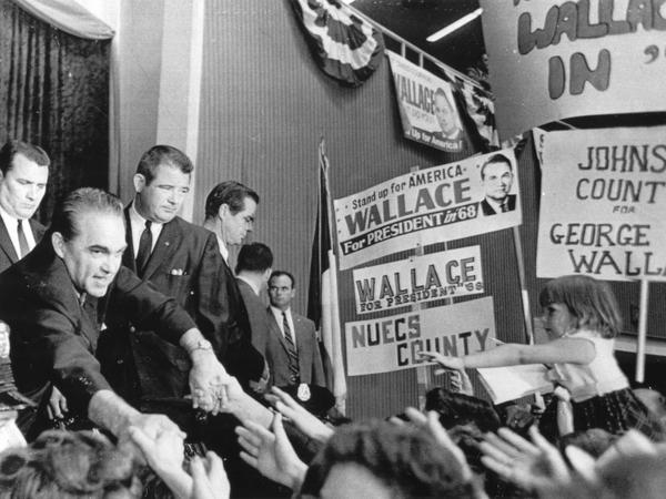 Presidential candidate George Wallace reaches out for the hands of his supporters at the Texas State Convention of his American Independent Party, Dallas, Sept. 17, 1968.
