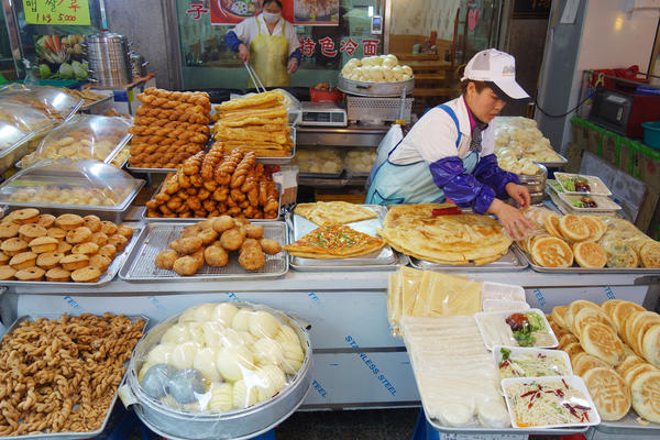 A food stall in South Korea's Wongok Village sells Chinese flatbreads and other snacks popular in China. Two-thirds of Wongok's residents are not ethnically Korean, and many of them are from China.