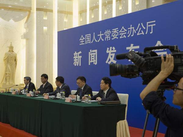 "Chinese officials answer questions about a new law regulating overseas nongovernmental organizations during a press conference at the Great Hall of the People in Beijing on Thursday. The new law subjects NGOs to close police supervision. ""We welcome and support all foreign NGOs to come to China to conduct friendly exchanges,"" one official said."