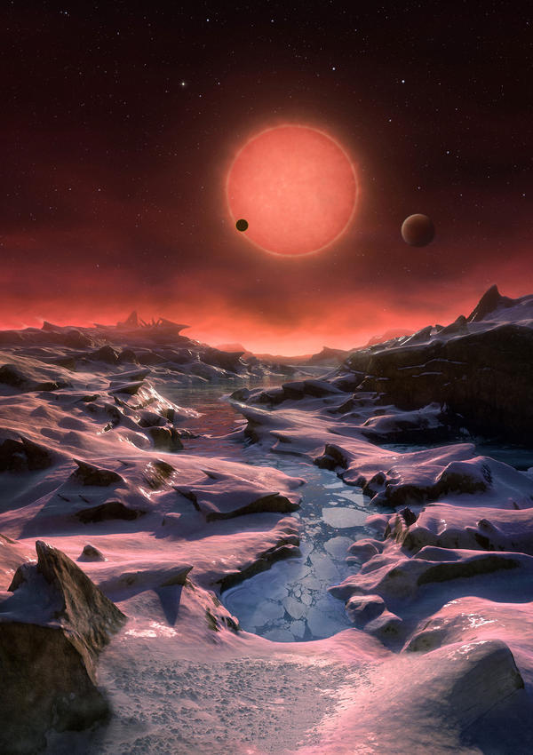 "The three planets depicted in this rendering have sizes and temperatures similar to those of Venus and Earth. They were discovered using the <a href=""http://www.eso.org/public/usa/teles-instr/lasilla/trappist/"">TRAPPIST telescope</a> at the La Silla Observatory in Chile."