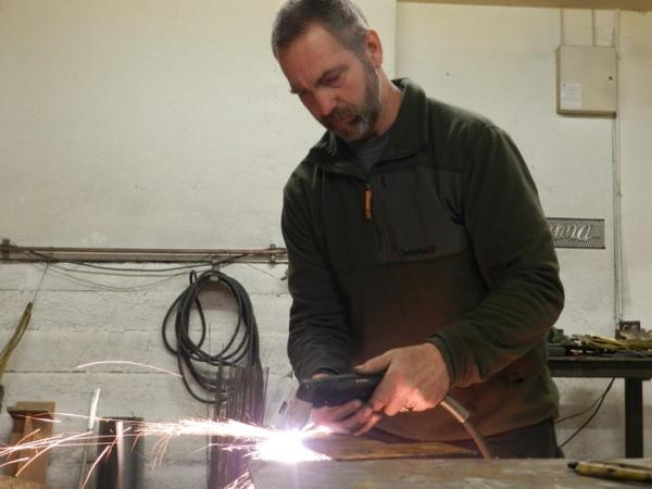 <p>Cascade Locks Port Commissioner and Nestle supporter Brad Lorang owns a gallery and makes metal art.</p>