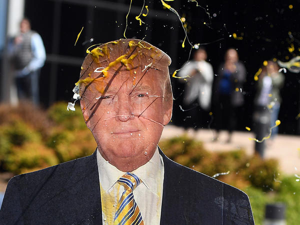 An egg is thrown at a cardboard cutout of Republican presidential candidate Donald Trump during a protest in Burlingame, Calif., last week.