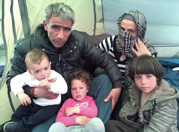 "Hassan Bekali (left); his wife, Maha; and their three children, Hamza (from left), Fatma and Ahmad, spent weeks at a makeshift migrant camp near the Greek village of Idomeni, holding out hope that they could reach Germany. ""We did not risk our lives and pay so much money to live in misery in a camp,"" Bekali says."