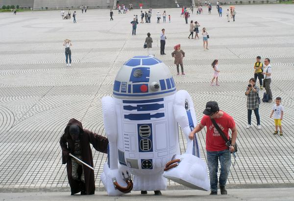 A <em>Star Wars</em> fan, dressed as R2D2, arrives during the annual Star Wars Day in Taipei, Taiwan, on May 4.