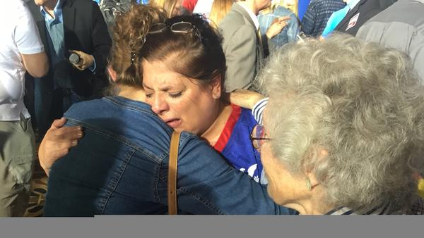 """Tearful Ted Cruz supporter Linda Bond hugs another supporter after her candidate exited the race Tuesday night. """"[I'm] sad, hurt. Hurt by Americans,"""" Bond said. """"I believe that they had an opportunity of a lifetime and instead gave in to anger and emotion instead of thought."""""""