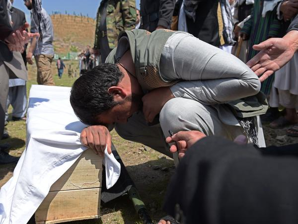 A relative weeps over the coffin of a victim killed in a Taliban truck bomb attack, at a funeral in Kabul on April 20. The attack, which took place a day earlier, tore through central Kabul and a fierce firefight broke out.