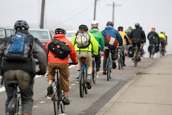 <p>Bike commuters travel down along a street May 12, 2011, in Portland, Ore.</p>