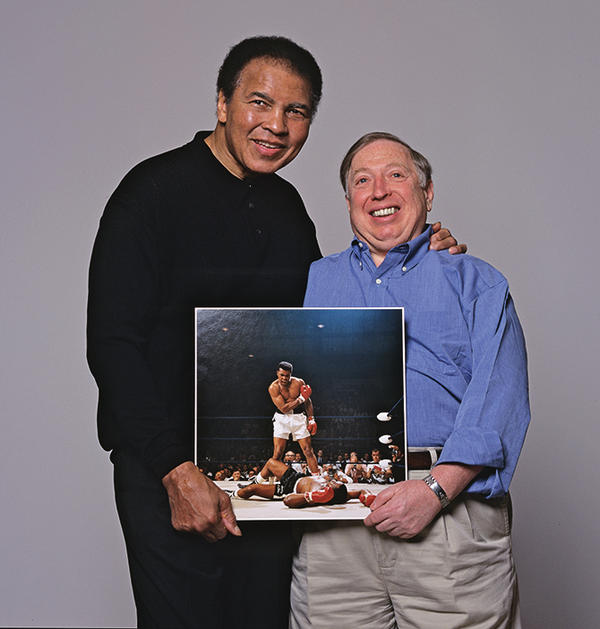 "Years later, Muhammad Ali and Leifer hold the iconic <a href=""http://neilleifer.com/portfolio/muhammad-ali-vs-sonny-liston-1965-world-heavyweight-title-2/"">Ali-Liston photograph</a> from 1965. Photo from <em>Relentless: The Stories behind the Photographs,</em> by Neil Leifer with Diane K. Shah (University of Texas Press, 2016)"