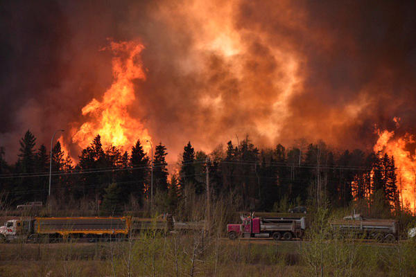 The wildfire rages along Highway 63 near Fort McMurray, Alberta, Canada, on Tuesday.