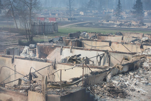 Home foundations are all that remain in a residential neighborhood destroyed by a wildfire on Friday in Fort McMurray.