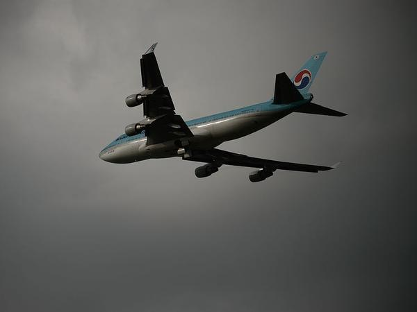 A Korean Air Boeing 747 aircraft takes off before storm clouds at Gimpo airport, south of Seoul.