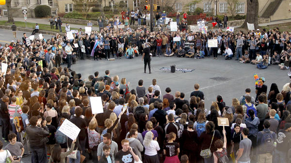 Hundreds attend a rally in Chapel Hill, N.C., on March 29 to protest the passage of House Bill 2. The state of North Carolina and the U.S. Justice Department are suing each other over the law's restriction on protections for lesbian, gay, bisexual and transgender people.