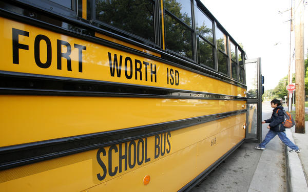 A student boards a Fort Worth Independent School bus in Texas in 2009. The new district superintendent is facing criticism for issuing guidelines on supporting transgender students.