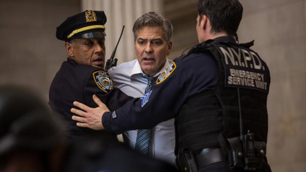 Giancarlo Esposito and George Clooney in Jodie Foster's thriller <em>Money Monster,</em> which never gets quite as crazy or convincing as, say, <em>The Big Short</em>.