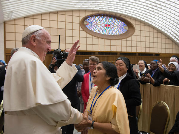 Pope Francis greets participants in a special audience with members of the International Union of Superiors General on Thursday in the Paul VI hall at the Vatican.