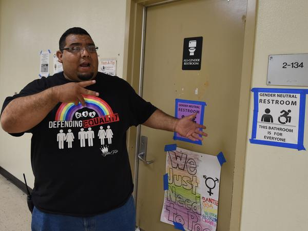 Jose Lara, dean of Santee High School in Los Angeles, talks about the transgender issue beside the school's gender-neutral restrooms. Schools have new governmental guidance on the issue provided by the Justice and Education departments.
