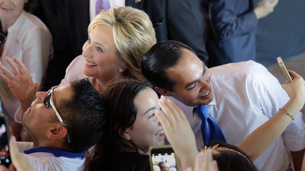 Hillary Clinton and Julian Castro, secretary of the Department of Housing and Urban Development, pose for photos with supporters in October in San Antonio.