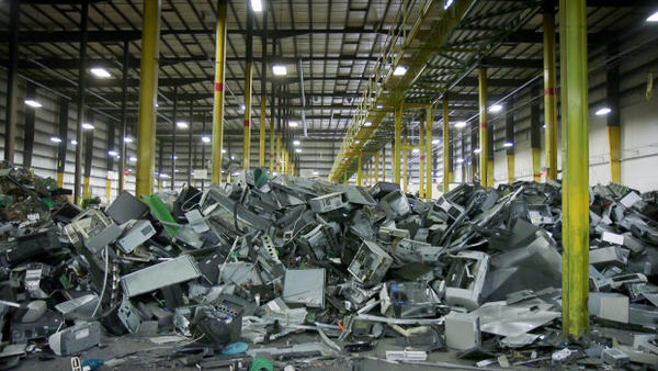 <p>Plastics and metals from dismantled electronics await their turn to enter a machine that shreds and sorts them into commodity type.</p>