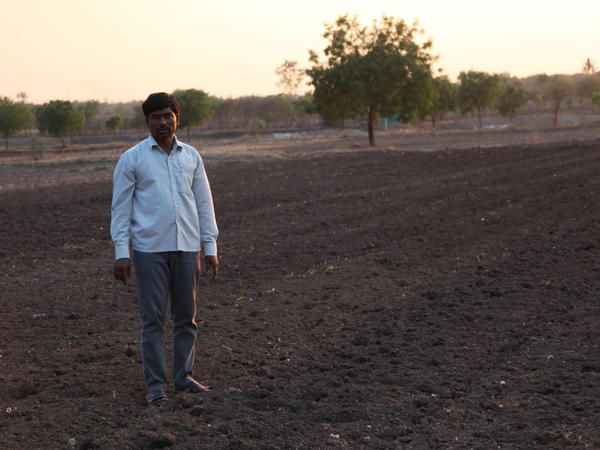 Dnyaneshwar Jadhav, whose younger brother killed himself, stands in his fields and says in a bid to survive he switched from cultivating water-guzzling sugar cane to less water intensive cotton. But the farm well, 60 feet, is dry and the ground water levels have sunk to new lows.