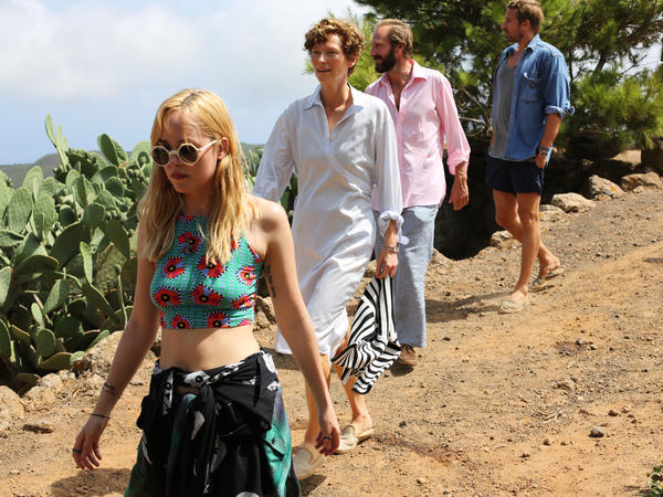 Penelope (Dakota Johnson), Marianne (Swinton), Harry (Fiennes) and Paul (Matthias Schoenaerts) are an unlikely foursome on the Mediterranean island of Pantelleria.
