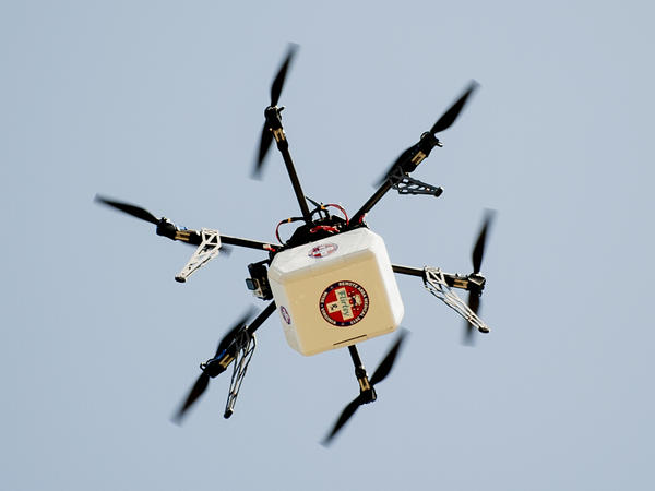 A drone takes a practice flight in Virginia with medical supplies — part of a project to evaluate the flying machines for use in humanitarian crises.