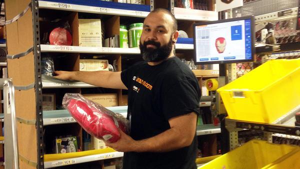 Warehouse employee Rejinaldo Rosales, 34, at work in Tracy, Calif.